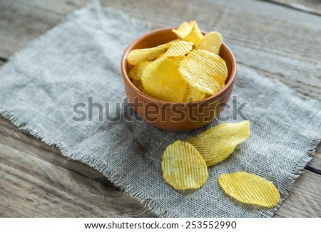 Potato chips in the glass bowl - stock photo