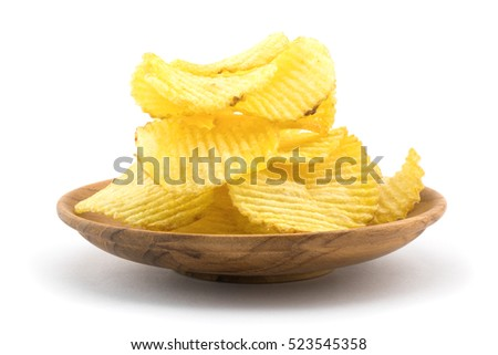 Potato chips in wooden plate on white background
