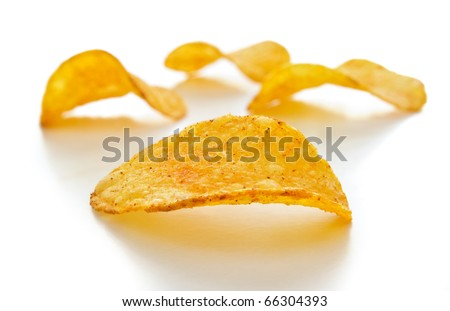 potato chips isolated on white with a shallow depth of field