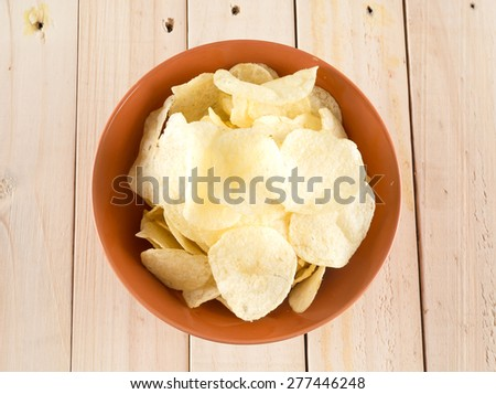 potato chips on wood background