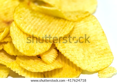 Potato chips pile on isolate white - copy space