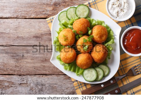 potato croquette balls with sauce on a plate. top view of a horizontal  - stock photo