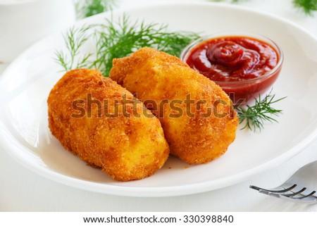 Potato croquettes with mozzarella. - stock photo