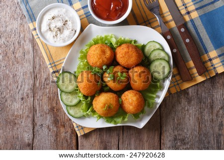 potato croquettes with sour cream and ketchup on a plate. horizontal view from above  - stock photo