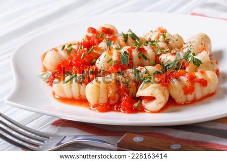Potato gnocchi with tomato sauce close up. horizontal   - stock photo