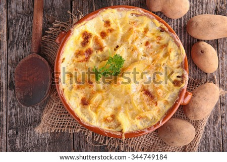 potato gratin with cream and cheese - stock photo