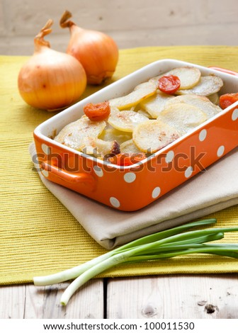 Potato Gratin with dried apricots and onion