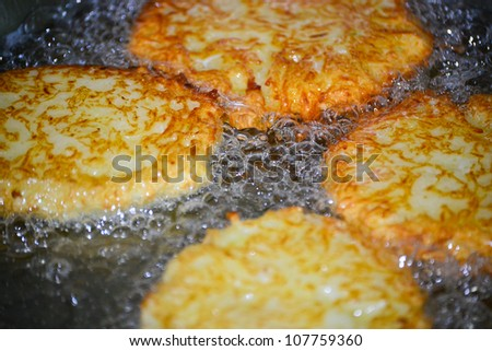 Potato latkes for Hanukah frying in oil