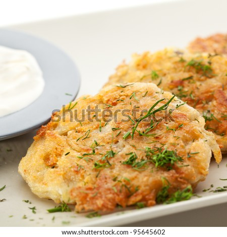 Potato Pancake with Sour Cream and Dill - stock photo
