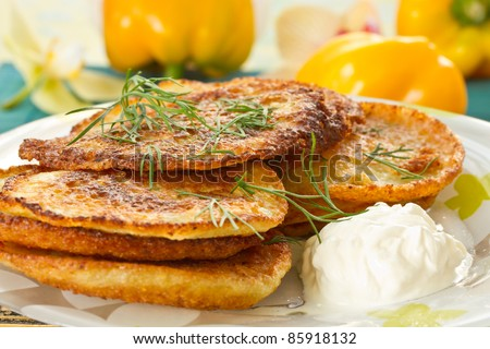 potato pancakes with dill and sour cream closeup