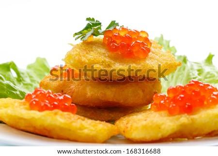 potato pancakes with red caviar on a white background - stock photo