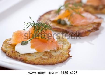 potato pancakes with smoked salmon - stock photo