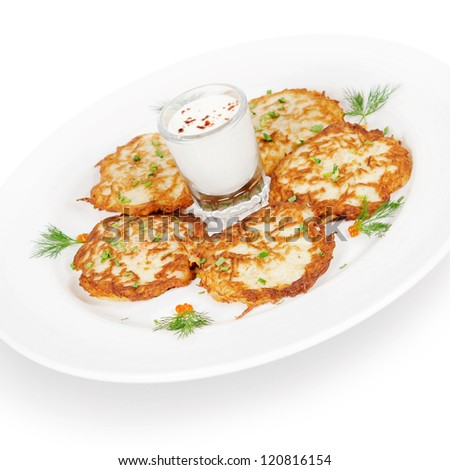 potato pancakes with smoked salmon and sour cream. isolated on white background
