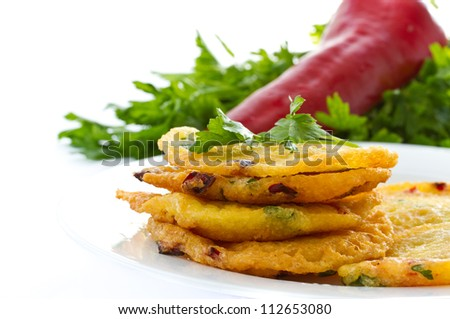potato pancakes with sweet peppers and parsley - stock photo
