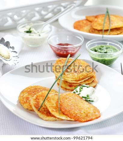 Potato pancakes with three different dips - stock photo