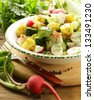 potato salad with cucumber and radish - stock photo
