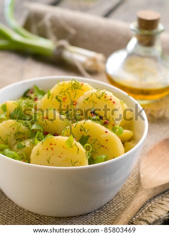Potato salad with parsley, dill and olive oil. Selective focus