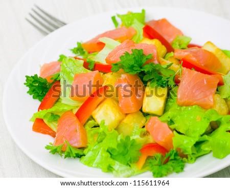 Potato salad with smoked salmon - stock photo