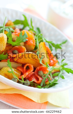 Potato salad with smoked salmon,capers,rocket and sauce