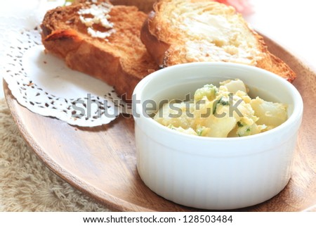 Potato salad with toast for breakfast image