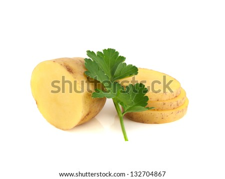 Potato sliced half and green parsley isolated on white background