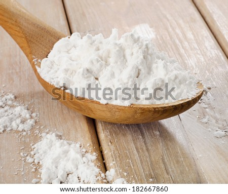 potato starch in a wooden spoon. Selective focus