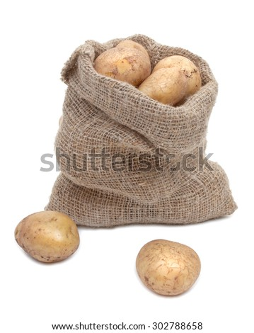 Potato tubers in a sack isolated on white - stock photo