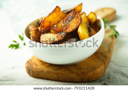 Potato wedges baked with oregano