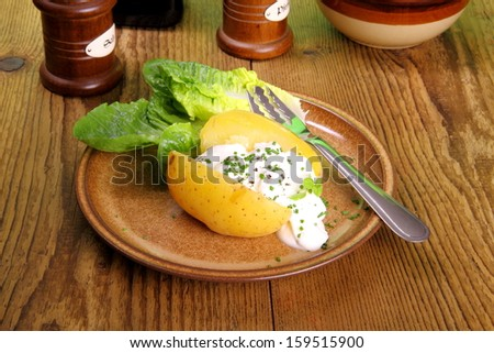 Potato with cottage cheese and salad, close up - stock photo