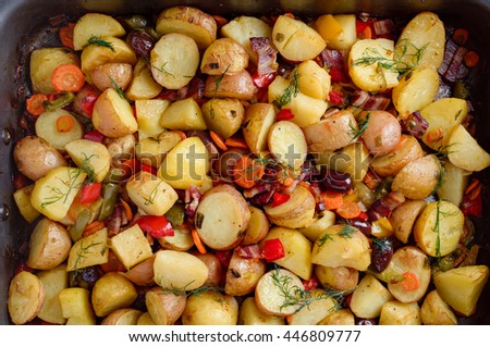 Potatoes baked with bacon, paprika, carrots, onions and several spices and olives.