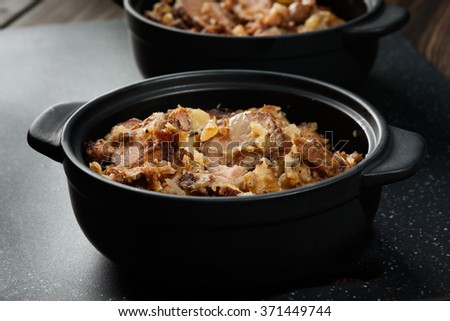 Potatoes baked with sausage and bacon. mystical light - stock photo