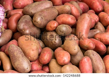 Potatoes for selling at vegetable market - stock photo