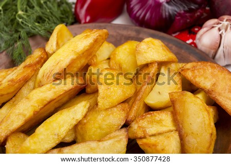 Potatoes fried in lard. Potatoes cooked in the style of rustic roasting. - stock photo