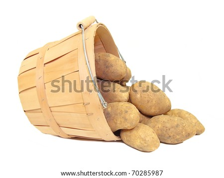 Potatoes in a wooden farmer's basket, isolated - stock photo