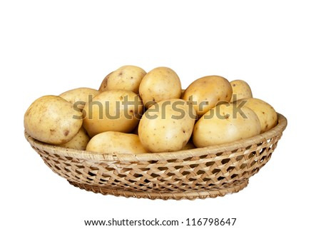 Potatoes in wicker basket isolated on white background