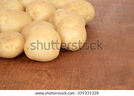 potatoes on wood - stock photo