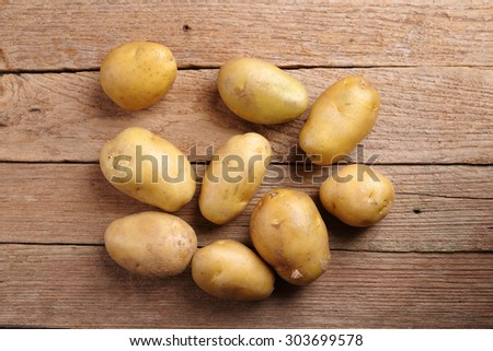 Potatoes on wooden