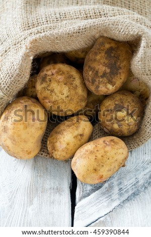 potatoes on wooden surface
