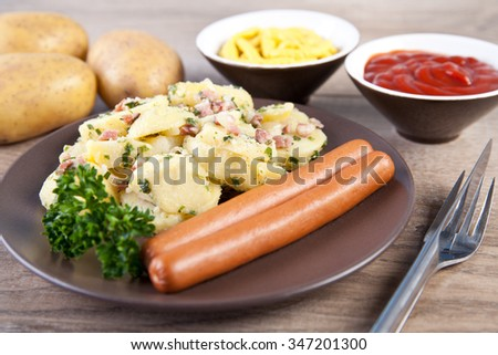Potatoes salad with wiener sausage - stock photo
