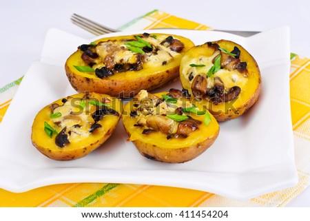 Potatoes Stuffed with Mushrooms and Cheese Studio Photo - stock photo