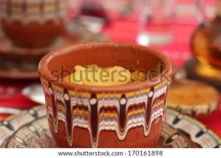Potatoes with meat in Bulgarian bowl - stock photo