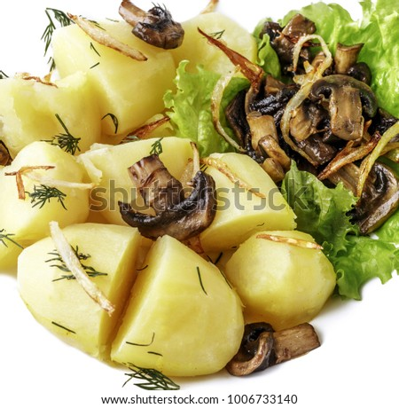 potatoes with mushrooms and lettuce on white background.
