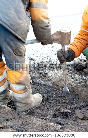 pothole and road surface repairing works; upgrading pavements and road surfaces - stock photo