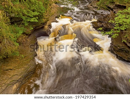 Potholes in the Presque Isle River in Northern Michigan - stock photo