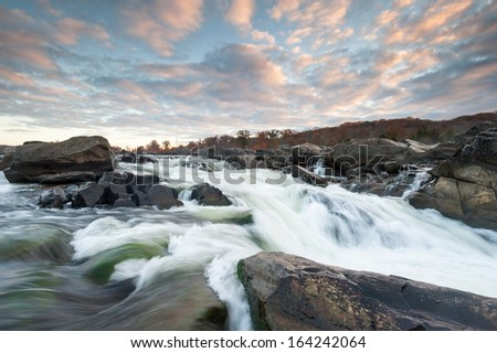 Potomac River Cascades Great Falls Park Sunrise Skies - stock photo