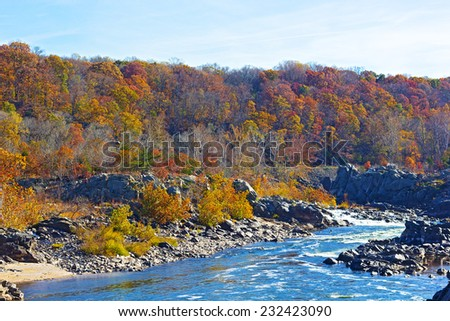Potomac River with rapids at Great Fall National Park, Virginia USA. Potomac River and trees in colorful foliage. - stock photo