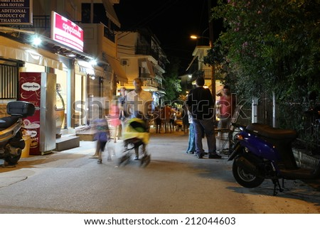 POTOS, THASSOS ISLAND, GREECE - 24 JULY 2014 Street shots in the night with long exposure - causing movement effects