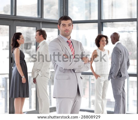 Potrait of a Businessman standing in Front of Business team - stock photo