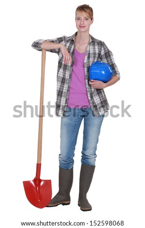 Potrait of a tradeswoman with her shovel - stock photo