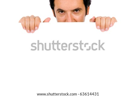 Potrait of a young guy holding blank billboard - stock photo